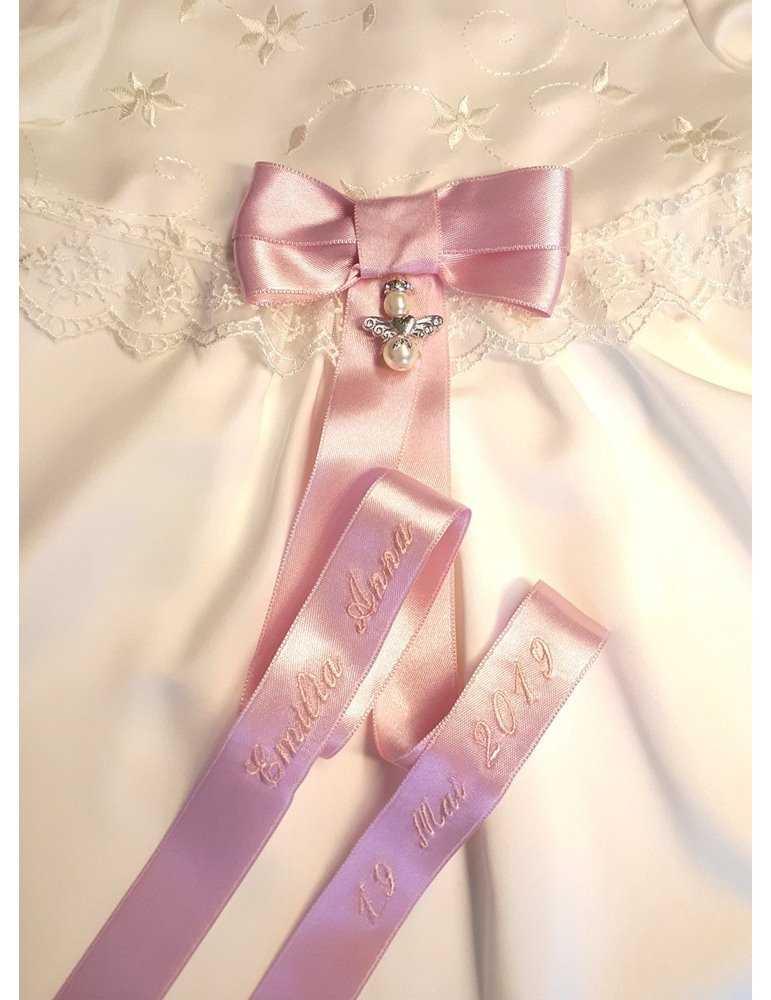 kritvit dopklänning med lyxrosett