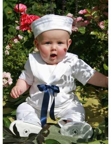 Dopklänning i lin med ljungfärgad doprosett