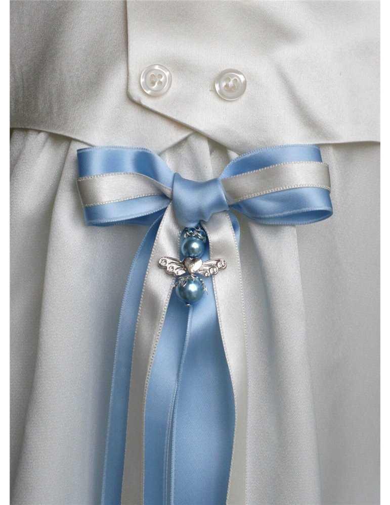 pojke och flicka i naturfärgade linne dopkläder